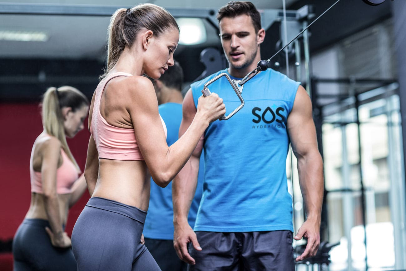 Trainer coaching electrolyte importance and benefits