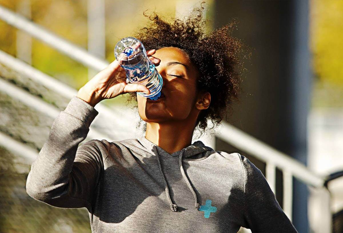 Healthy Woman Drinking Water - SOS Hydration