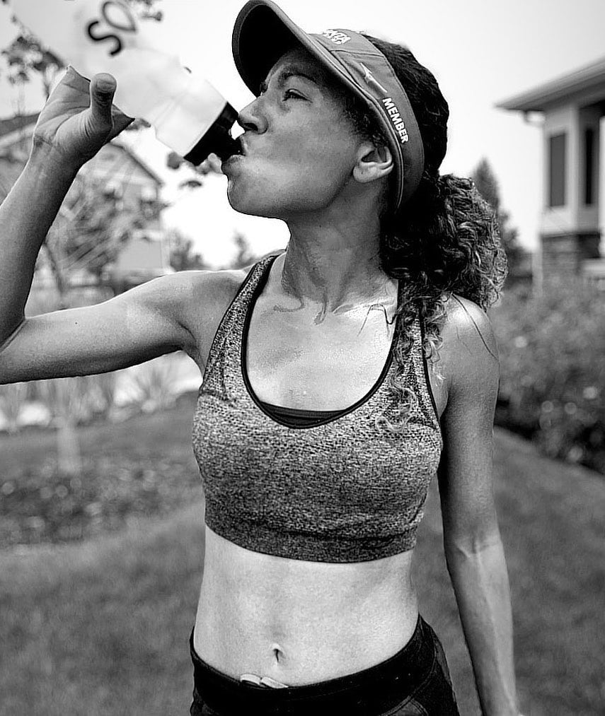 Female Runner Drinking Electrolyte Drink Water