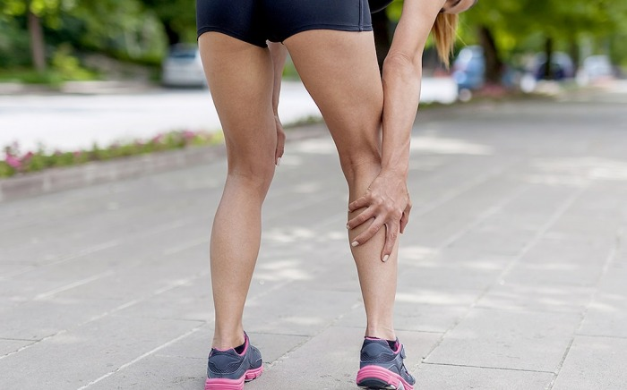 Athlete with Leg Cramps while Running