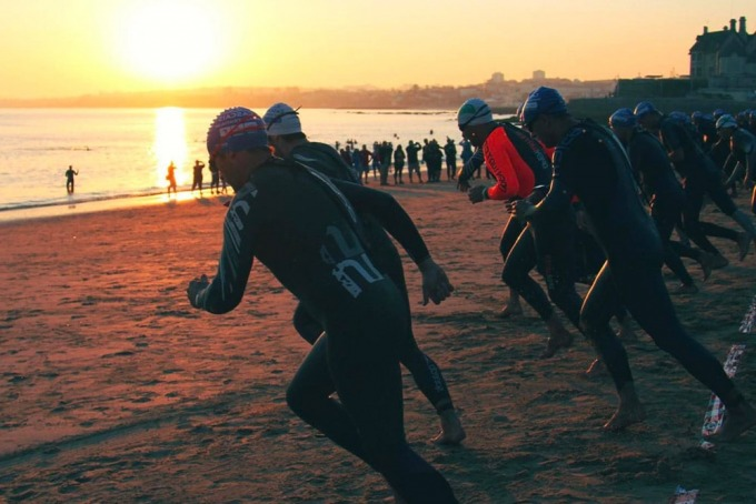Triathletes Running at the Beach